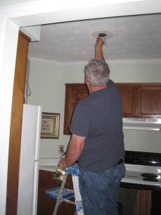 Dad replaces light in kitchen April 2017